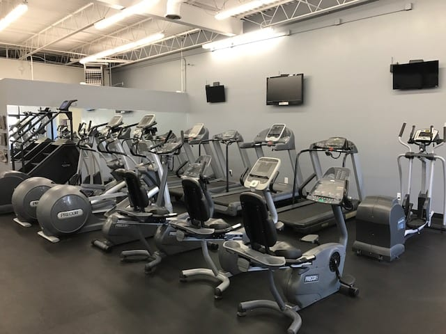 cardio training area with tv's suspended from wall at albuquerque gym