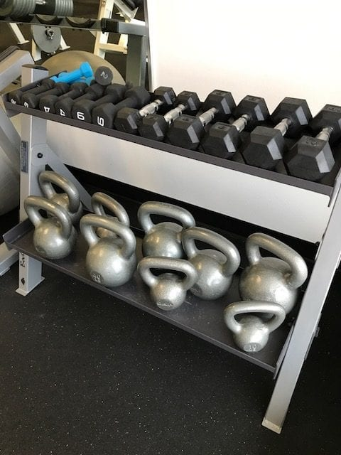 kettlebell rack in various weights in strength training area of powerflex gym in albuquerque nm