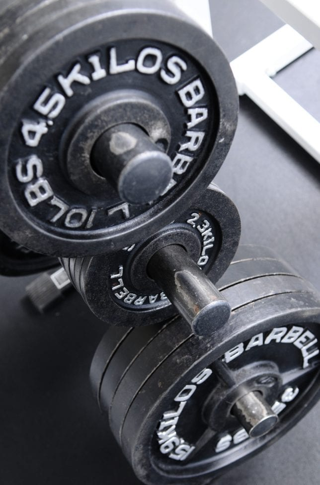 weight plates at gym for strength training
