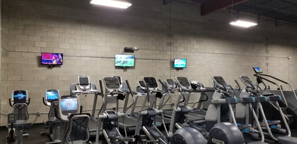 cardio training with tv's mounted on wall at ventana powerflex gym in albuquerque nm